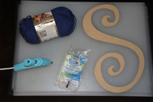 Supplies: Yarn Hot Glue Gun (and glue) Letter (mine is wood) Scissors Ribbon