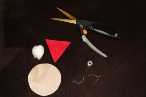 Supplies: Felts (tan for the cookie and a color for the jelly) Stuffing material Needle and thread Scissors