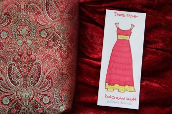 Red crushed velvet, gold and red brocade with my sketch of the front of the dress