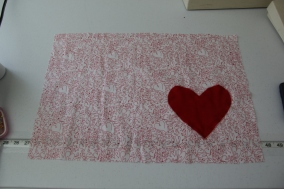 Patterned place mat with solid heart