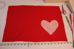 Solid place mat with patterned heart