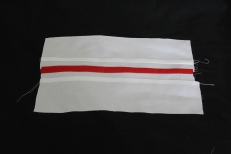 cuffs sewn up with red place holder