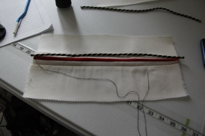 Sewing the cording on by hand